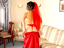Naughty milf nymphette nelly peels off her red wedding gown and rubs her swollen clit