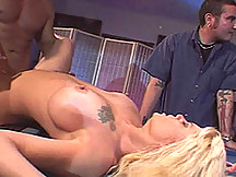 Buff stud sticks it to a married woman while her man watches