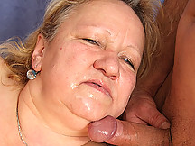 Two guys fuck the fat mature blonde and then cum on her body in various places