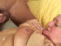 The old babe with the steaming hot pussy lets him do her mouth and her hole from behind