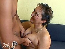 Mature gets young guy's cock