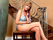 Busty cougar Nicole Moore tortures her milf juice box with the rabbit toy